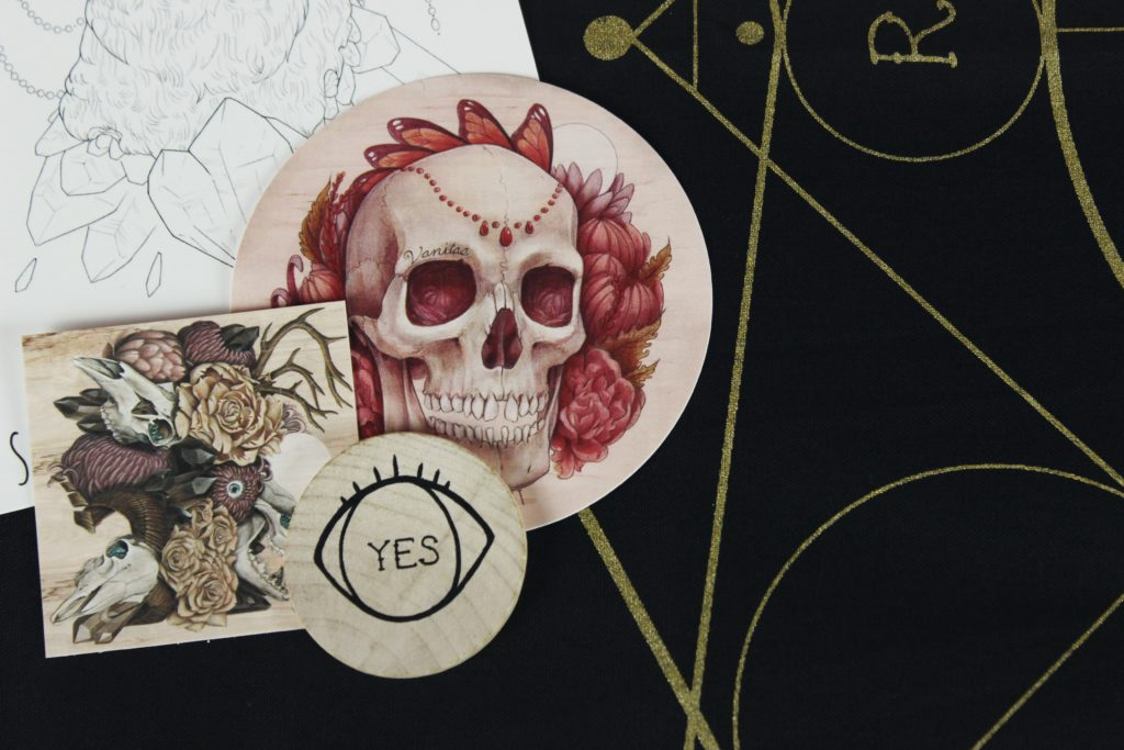 The word Yes inside of an eye with skulls illustrations