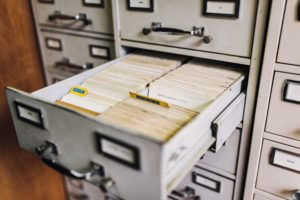 A card catalog with two open drawers