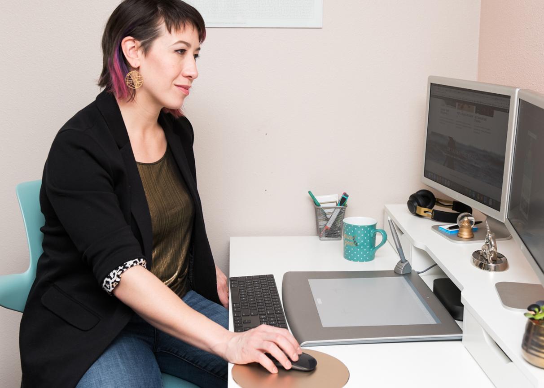 Website designer working at a desktop computer