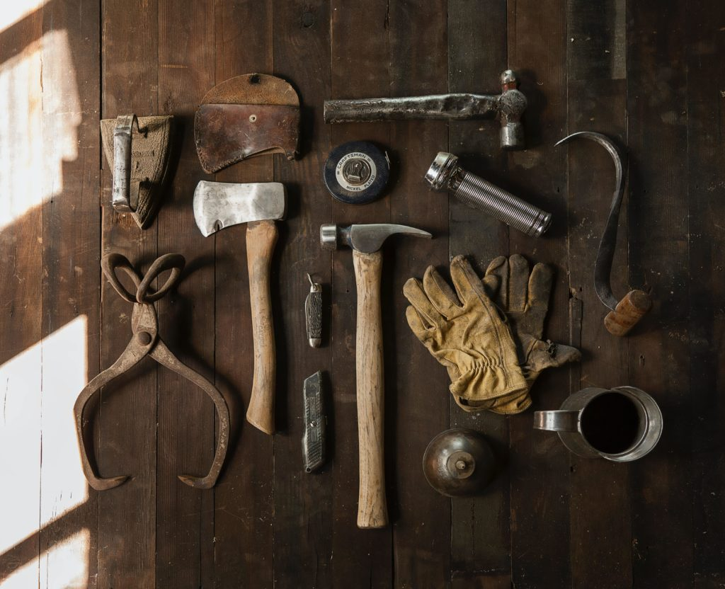 Old timey construction tools shown from above, representing how to build an SEO foundation with Good Content
