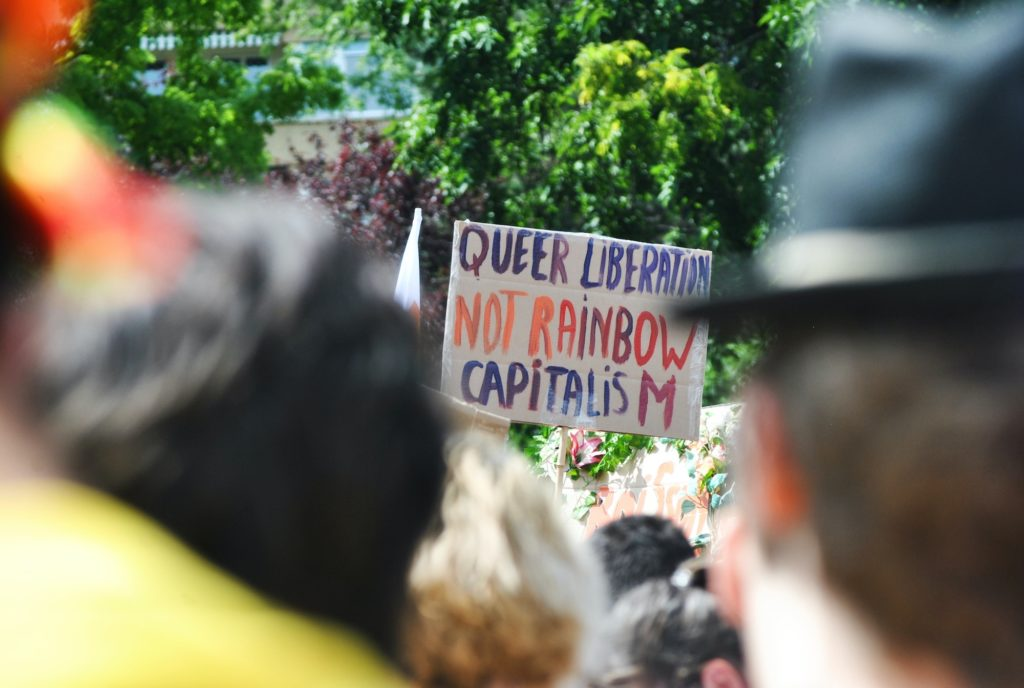 """sign at Pride event reading """"Queer Liberation Not Rainbow Capitalism"""""""
